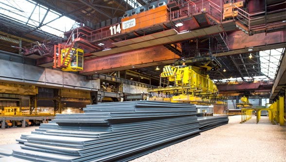 Steel-plant-warehouse-with-sheet-metal-piles