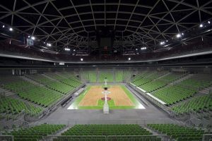 Large-indoor-arena-with-basketball-court-in-the-middle